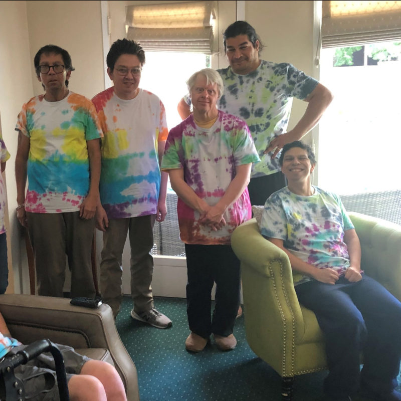 Residents of the Alma house in Tie Die shirts.