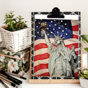 Sample of sip and sketch painting, statue of liberty with a flag in the background.