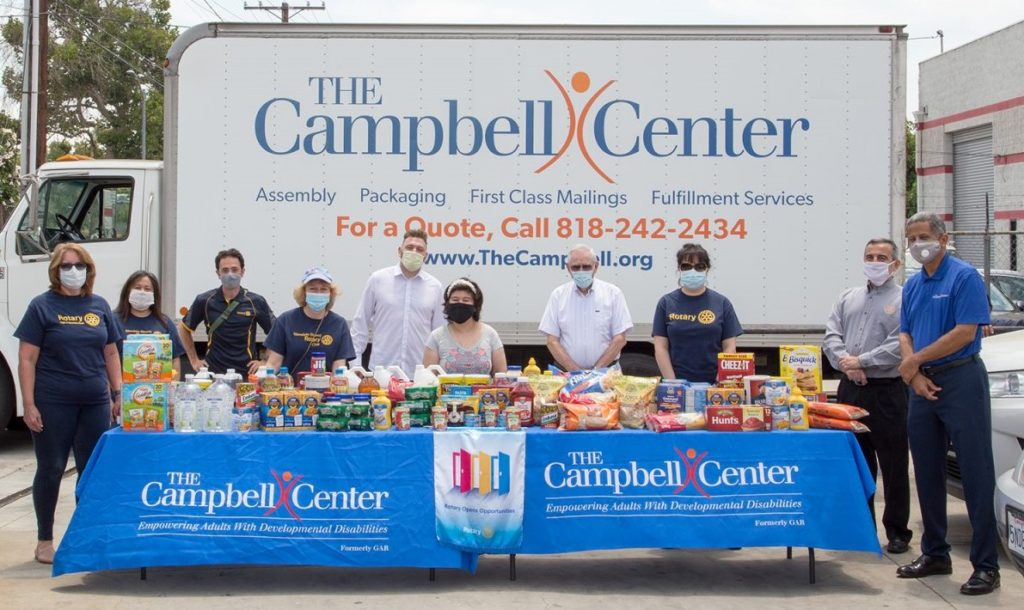 People Standing in front of Food Drive
