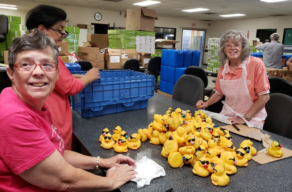 two women in workshop with rubber ducks